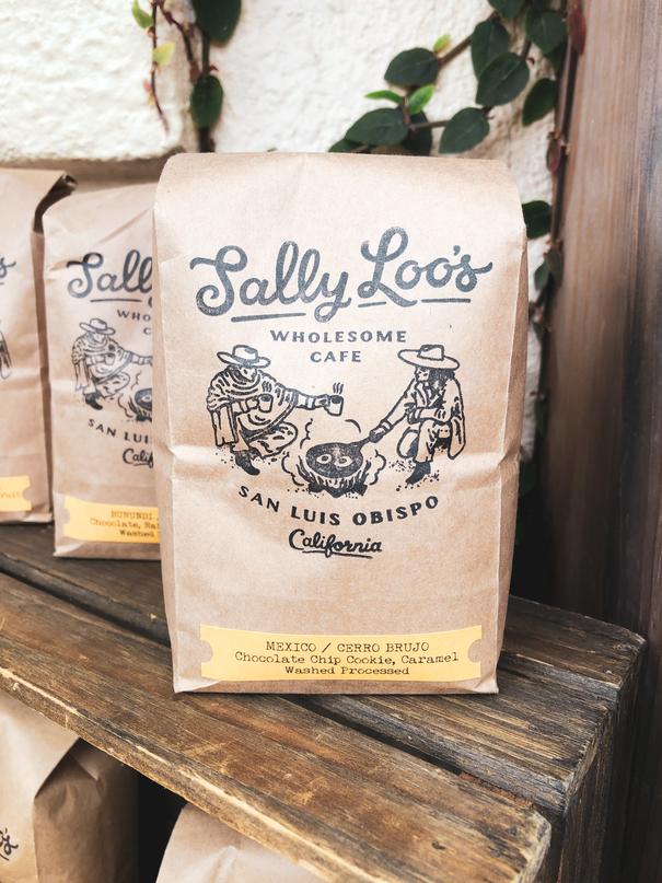 Image of brown bag of coffee sitting on wooden.best coffee in san luis obispo Sallly-Loos-Coffee-San-Luis-Obispo